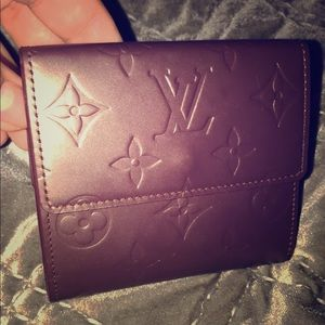 Louis Vuitton wallet. Coin, cards and bills.